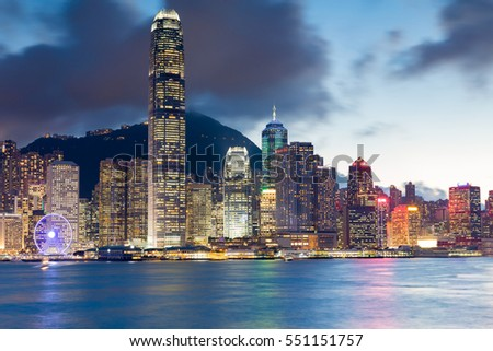 Hong Kong office building night lights over Victoria bay