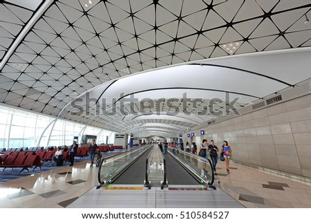 HONG KONG - SEP 23: The passengers and escalator in modern interiors building in Hong Kong International Airport on September 23, 2016 in Hong Kong. inside of Hong Kong International Airport