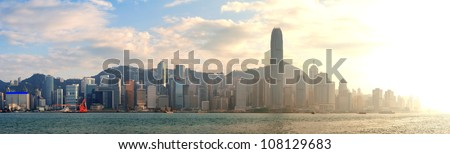 Hong Kong Victoria Harbor in afternoon with urban city skyline and colorful cloud