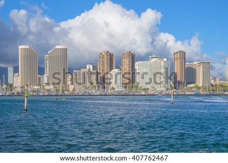 Honolulu, Hawaii, USA, April 19, 2016:  Afternoon sea view of the waters of Waikiki with the Ala Wai Harbor and hotels in the background.