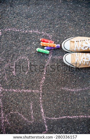 Hopscotch on the ground on asphalt with colorful street chalk