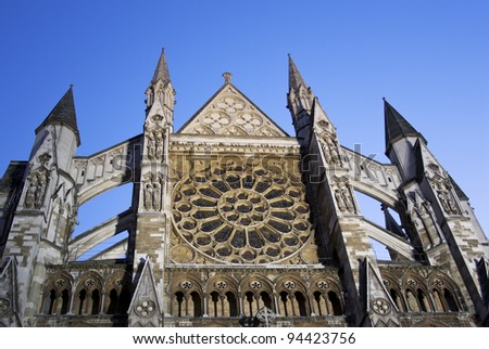 horizontal close up photo of top of front of Westminster abbey in London