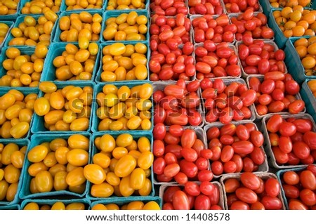 Horizontal photo of yellow and red plum tomatoes at local farm market