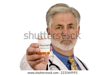 Horizontal Shot Of Doctor With Prescription Medicine On White Background/ Focus On The Front Of Bottle