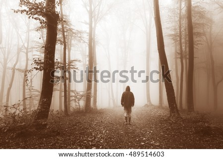 Horror dark man in silhouette in foggy forest