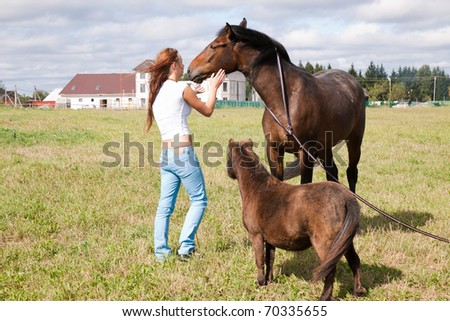 Horse, pony and girl