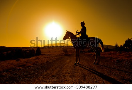 horse-riding at sunset background