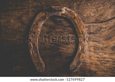 horseshoes on wooden background - vintage style photo
