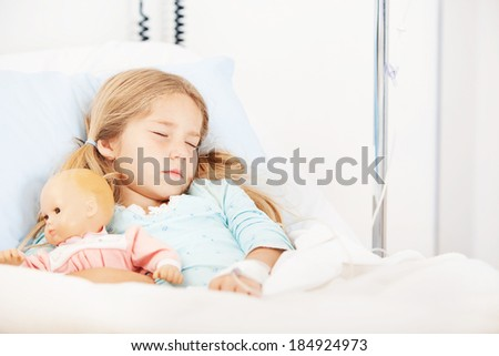 Hospital: Little Girl Asleep In Hospital Bed With Doll