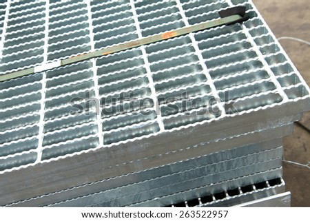 Hot-dip galvanized steel grating bunch on the rack in warehouse before shipment