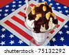 hot fudge sundae on patriotic background - stock photo
