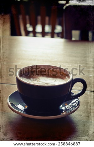 Hot morning Italian latte with cream in rustic atmosphere
