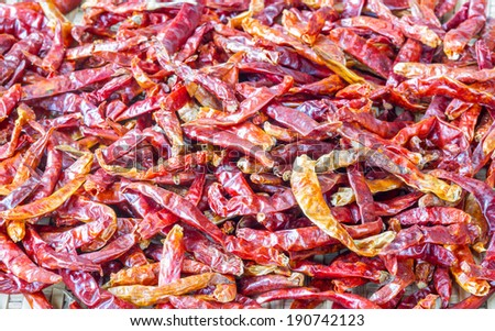 Hot red dry chili or chilli pepper many background.