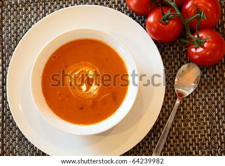 Hot Tomato Soup with Tomatoes and Spoon