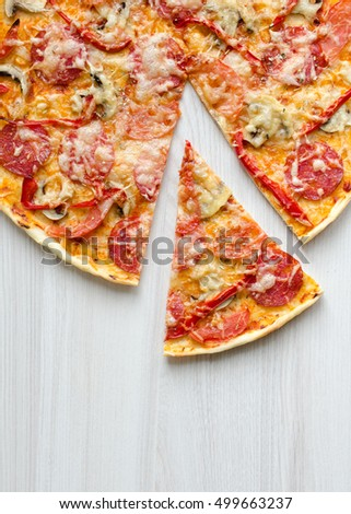 Hot true pepperoni italian pizza with salami and cheese