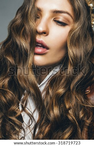 hot woman with curly long hair and passionate lips