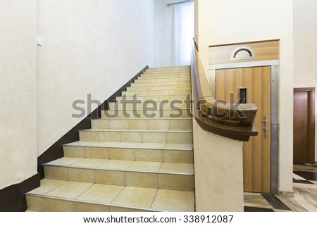 Hotel lobby interior with elevator and stairs