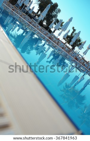 Hotel swimming pool in the summertime
