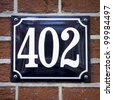 house number 402 - stock photo