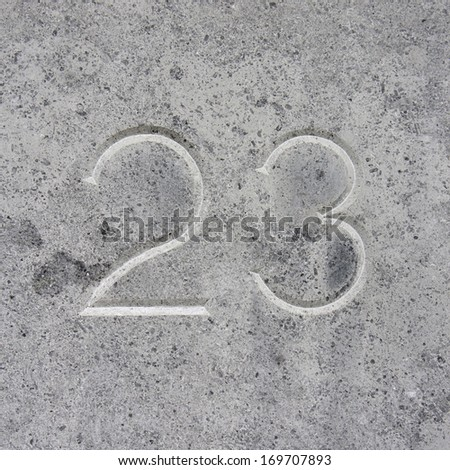 house number twenty three, carved in stone.
