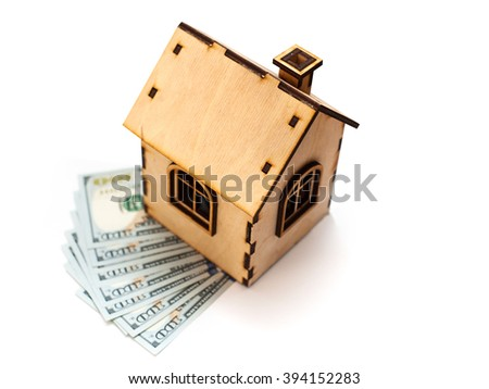 House shape made of wooden blocks and currencies dollar lying on electrical construction