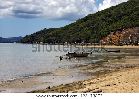 house tree boat sand lagoon tropical and coastline in madagascar nosy be