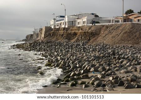 Houses along the coastline of Punta Hermosa, Peru