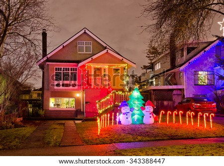 houses neighborhood decorated and lighted for christmas and for new year eve night in - Lighted Christmas Houses