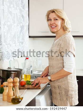 Housewife cooking vegetarian soup at home
