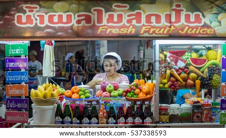 HUA HIN, THAILAND - JANUARY 23: Fruit seller at the famous night market on January 23, 2016 in Hua Hin. Hua Hin is a major tourist destination in northern Thailand.