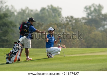 HUAHIN, THAILAND-FEBRUARY 12: Paopong Pinprayong of Thailand thinks of his next move during Round 1 of 2015 True Thailand Classic on February 12, 2015 at Black Mountain Golf Club in Hua Hin, Thailand