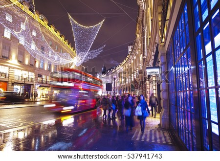 Huge angels made of lights hanging over Regent Street in London at Christmas Time - LONDON / ENGLAND - DECEMBER 10, 2016