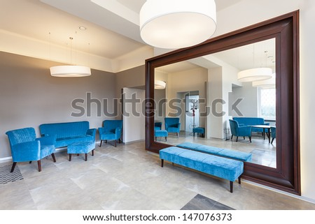 Huge mirror with frame nad colorful furniture