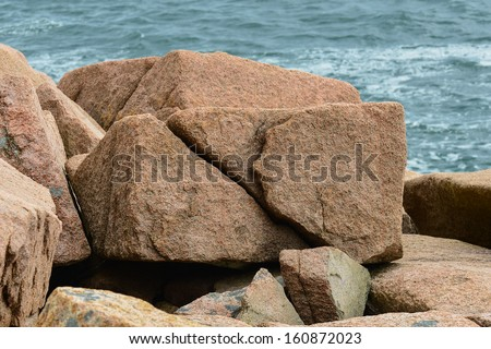 Huge pink granite slabs of boulders on the Maine coast