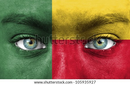 Human face painted with flag of Benin