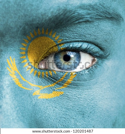 Human face painted with flag of Kazakhstan