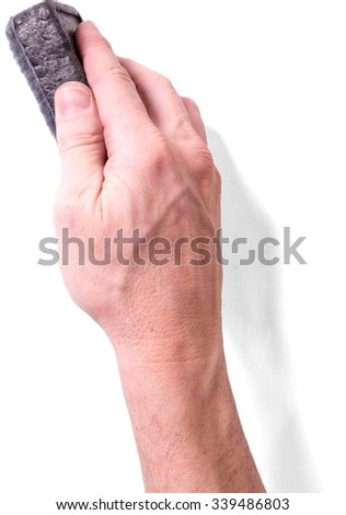 Human Hand Holding a Whiteboard Sponge Eraser - Isolated