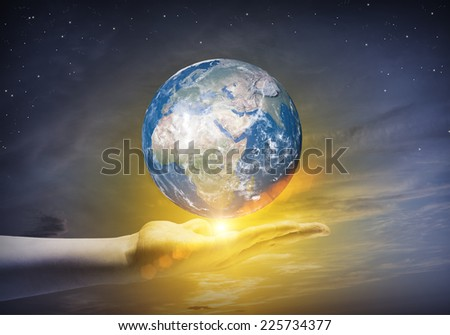 Human hand holding Earth planet. Elements of this image are furnished by NASA