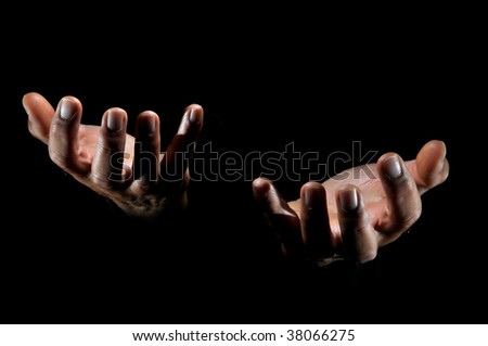 Human hands isolated in a black background