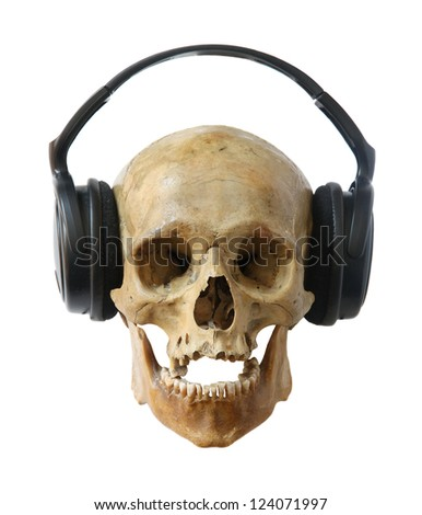 Human skull dj in headphones isolated on a white background.