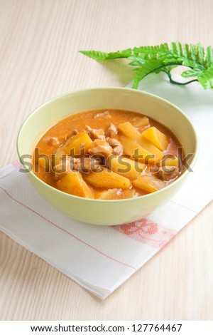 Hungarian goulash with white napkin on wooden table