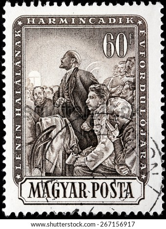 HUNGARY - CIRCA 1954: A stamp printed by HUNGARY shows image portraits of Vladimir Lenin and  Joseph Stalin at communist meeting, circa 1954.