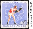 HUNGARY - CIRCA 1970: A stamp printed in Hungary showing Box fighter, circa 1970 - stock photo