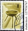 "HUNGARY - CIRCA 2001: A stamp printed in Hungary, shows antique Three-legged stool, by Janos Vincze, 1910, with the same inscription, from series ""Furniture Type"", circa 2001 - stock photo"