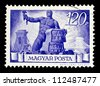 "HUNGARY - CIRCA 1945 : A stamp printed in Hungary shows worker, without inscription, from the series ""Reconstruction"", circa 1945 - stock photo"