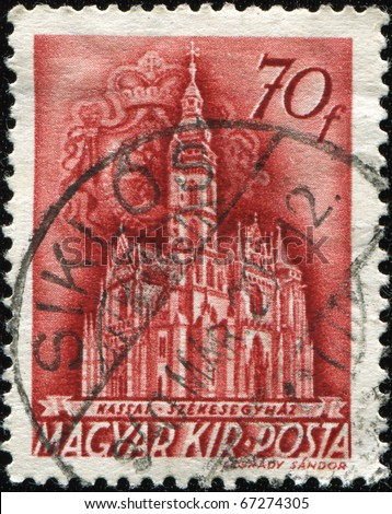 HUNGARY - CIRCA 1939: A stamp printed in the Hungary shows Cathedral of Kassa with the Rakoczi coat of arms in background, circa 1939