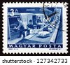 HUNGARY - CIRCA 1964: a stamp printed in the Hungary shows P.O. Parcel Conveyor, circa 1964 - stock photo