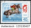 HUNGARY - CIRCA 1969: stamp printed by Hungary, shows an equestrian competition, circa 1969 - stock photo