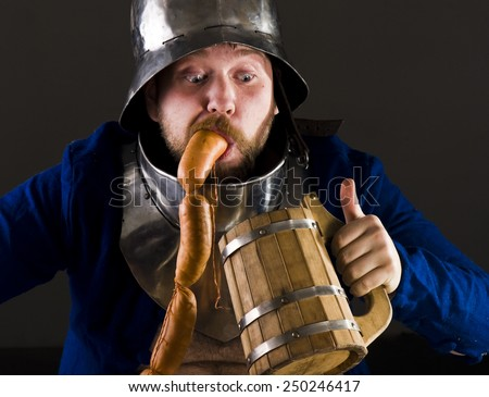 Hungry man in medieval suit