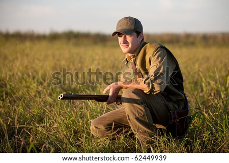 Hunter waiting silently for the hunt during the hunting season